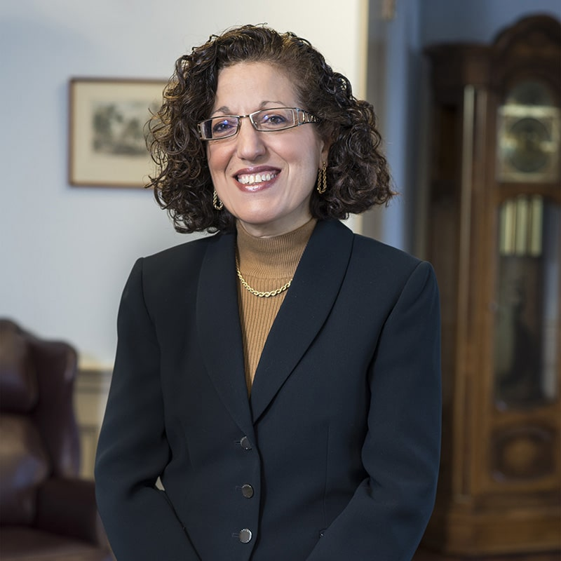 Lauren Puglia smiling in an office setting.