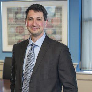 Scott Wittlin smiling in an office setting