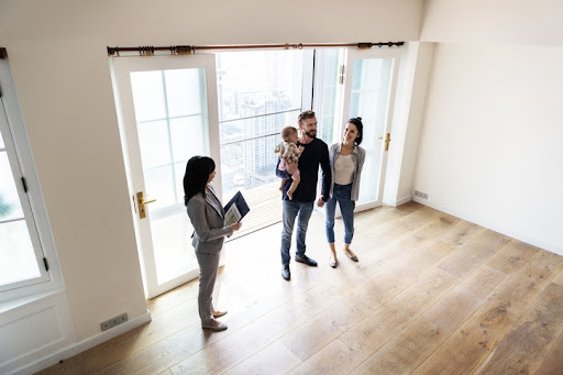Without due diligence, condo owners may pour all their savings into properties that need significant repairs, or aren't well managed. A young couple touring a condo with their real estate agent.