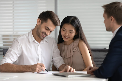 This young engaged couple has chosen to discuss their finances before the wedding and is signing their prenuptial agreement.